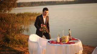 young man preparing for a date and decorates the table