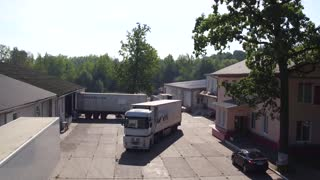 Aerial view of Trucks which leaves the meat factory