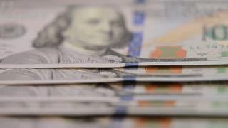 American hundred dollar bills.close up dolly shot of American paper money bills. Cash money background. Benjamin Franklin portrait on 100 US dollar bill close up