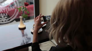 Attractive young woman Photographing food in restuarant cafe