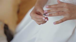Beautiful bride puts ring.morning bride
