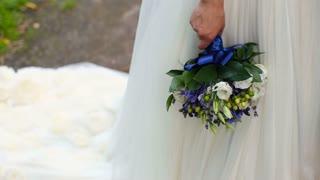 Beautiful wedding bouquet in hands of bride.Bride holds a wedding bouquet in her hands.Wedding bouquet in hands of the bride.