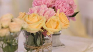 Beautiful wedding table decoration, flower arrangement and candles, a banquet for the guests