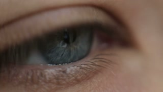 blue eye in macro footage of young handsome man