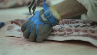 Butcher Cutting Pork Meat in Meat Factory. Fresh raw pork chops in meat factory. Meat processing in food industry. Production line in meat processing plant.