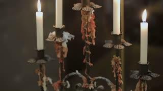 Chandelier burning on elegant, romantic decorated table in restaurant.