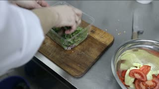Chef chopping vegetables. Close-up of chef hands cooking and preparing food in restaurant  kitchen