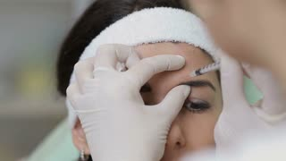 Close up of young woman having a botox injection at beauty salon