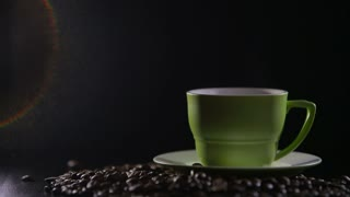 Cup of hot coffee with steam over black background