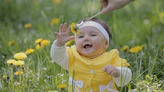 Cute little girl having fun in backyard with flowers
