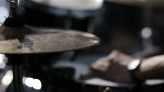 Drummer playing on drum set. close up. Drummer on stage