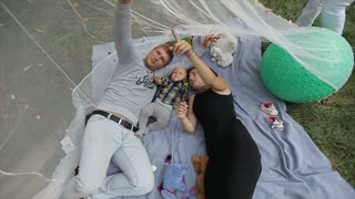 Happy family have fun in beatiful decoretion. Little baby have fun with his parents