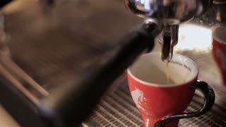 making coffee espresso in a bar with professional machine