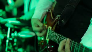 Man playing a guitar at a rock concert. Guitar close up. guitarist playing at a nightclub