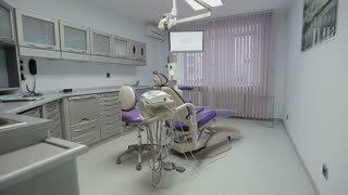 Office of the dentist being empty and ready for work, crane shot