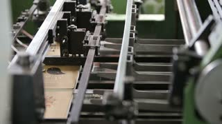Production line at a print factory, fixing paper, close up