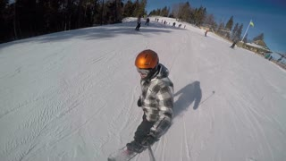 SELFIE: Snowboarder speeding down the ski slope
