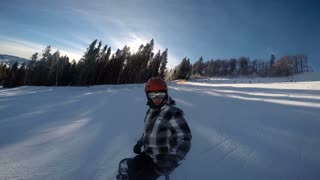 SELFIE: Snowboarder speeding down the ski slope