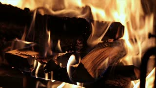 Slow motion of Fireplace burning. Warm cozy burning fire in a brick fireplace close up. Cozy background.