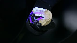 Technician creating a model for cermet implant.