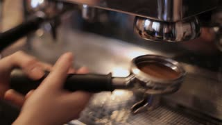 The bartender makes coffee with professional machine. closeup