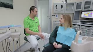 The patient consults a dentist. The patient is in the dental chair. Consultation of the dentist. A visit to the dentist's office.