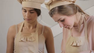 two young women are preparing macaron
