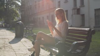 A beautiful girl using an app on her smartphone in the morning city