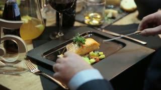 A man eats a fish dish