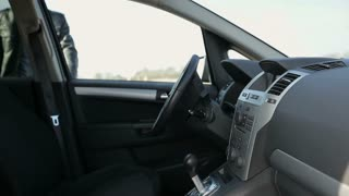 A man getting into a car