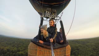 Adventure. Beautiful romantic couple hugging in bascket hot air balloon