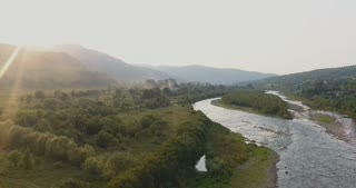 Aerial View. Flying over the beautiful mountain River and beautiful forest. Aerial camera shot.