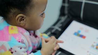 african baby watching cartoons on TabletPC
