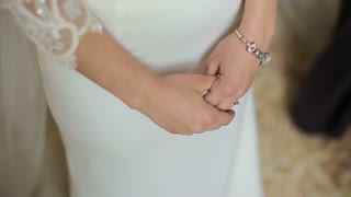 Beautiful bride hands. Beautiful bride will meet with groom