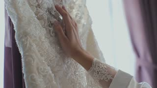Beautiful bride's morning in the hotel room. Wedding Dress