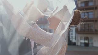 Beautiful Wedding couple hugging and kissing