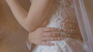 Beautiful wedding couple hugging