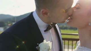 Beautiful Wedding couple kissing on the background of sunset