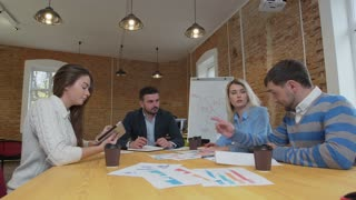 Business team meeting involved diverse people participating in creative sustainable ideas steadicam shot across boardroom table shared work space