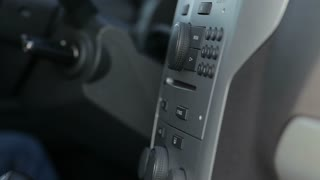 Car CD player - putting a CD into a car music system