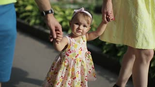 Cute little girl having fun. Happy family have fun in backyard. Little girl have fun with her parents