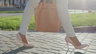 Filmed feet only young business woman walking to the office