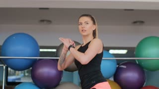 Fitness, sport, training, gym and lifestyle concept - stretching young woman in the gym