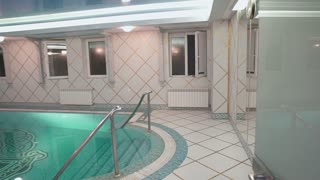Interior of wellness and Spa swimming pool.Hotel pool. Swimming pool inside a hotel.