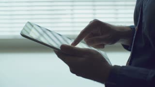 Man hand touching tablet computer surface touchscreen