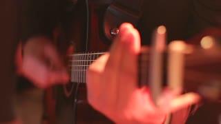 Man playing a guitar at a rock concert. Guitar close up. guitarist playing at a nightclub