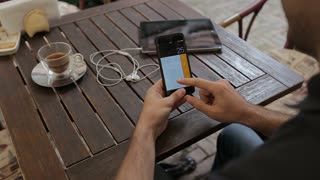 Man use calculator software on smartPhone.