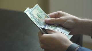 Man's hands counting money dollar bills.close up