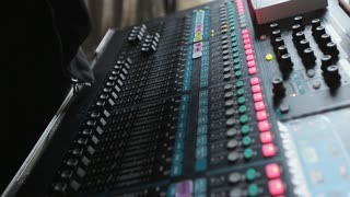 Music mixing console. The man tunes the sound