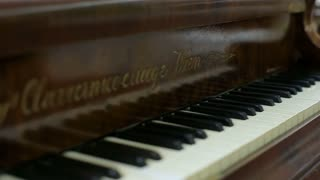 Old piano in the living room. Home interior. classic apartment
